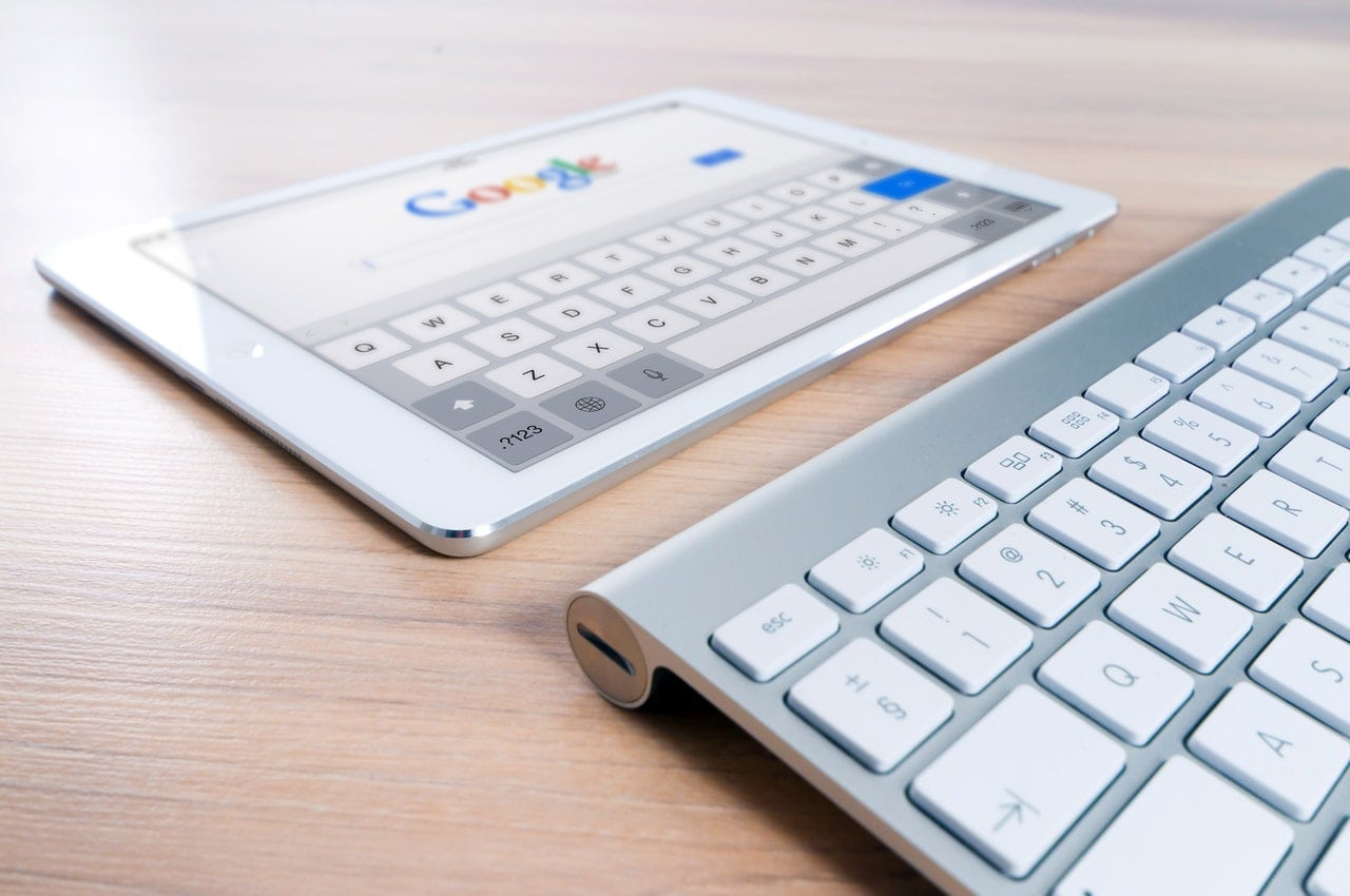 Google pulled up on an iPad with an Apple keyboard nearby