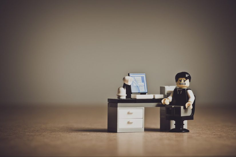 Lego employee at a desk